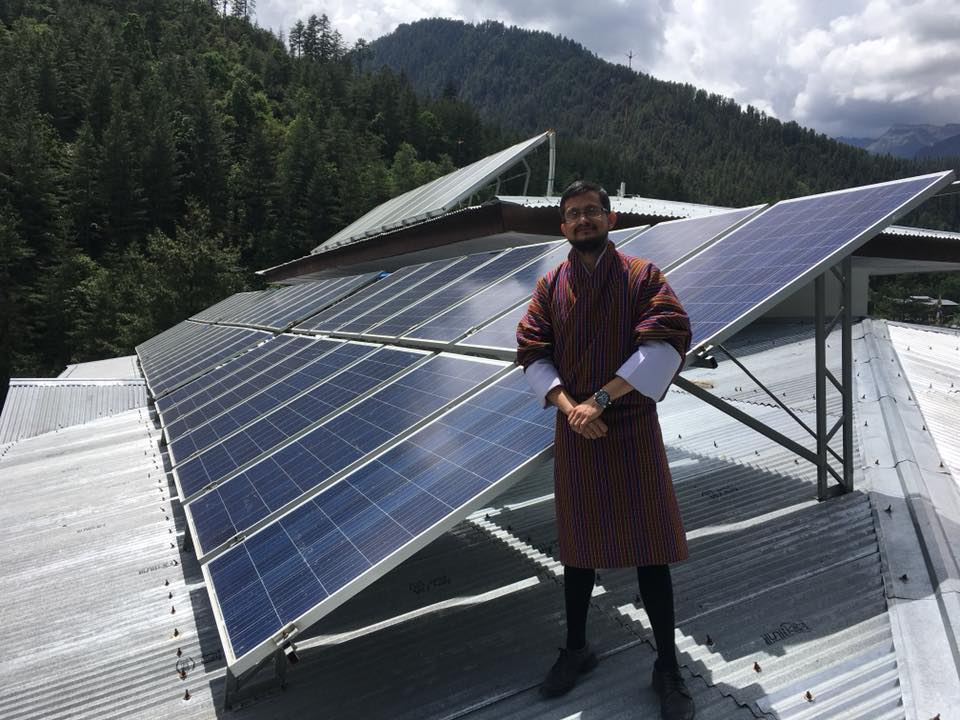 Deependra in front of his solar pv project
